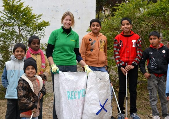 Judith Underhill with a group of children who were part of recent clean-up drive in Dehradun