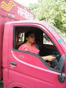 Tulsi Tewari driving the red-colored mini truck that carries mails from all over the world to small hill towns. Photo by Rakesh Agrawal.