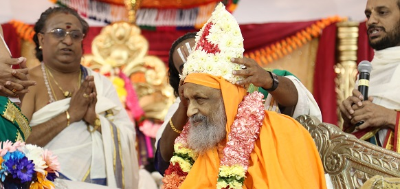 Temple officials welcome Swami Dayananda Saraswati to Ijamsville, MD, on Saturday, September 14, 2013.