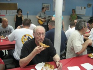 A Slice of Hope pizza party in Vegas, with live musician in background