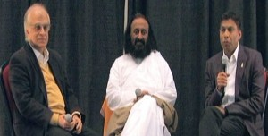 """Rajiv Malhotra, Sri Sri Ravi Shankar and Naveen Jain answer questions from the audience at the """"Big Ideas for a Better India"""" conference at University of Maryland on Sunday."""