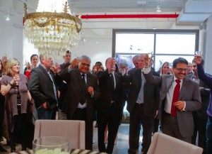 CEO Arun Agarwal (far right) and company toast the opening of Alok International's new Manhattan showroom