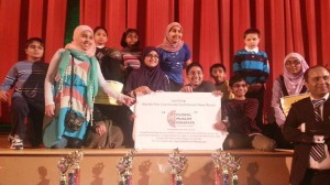 Tausif Malik (far right) with the winners of the 2013 Muslim Spelling Bee.