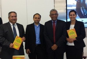 Ravi Venkatesan (second from right) poses for a photo after signing copies of his book.