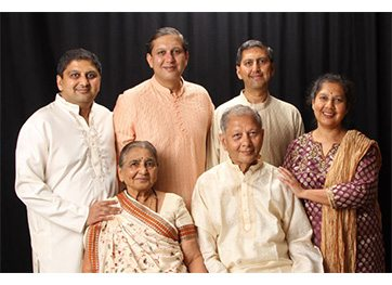 The Mehta Family - Back row from left to right: Siblings Dharmesh, Jay, Rahul and Nisha; Front row: Parents Jyoti and Bhupat.