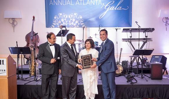 Faizal and Shabana Kottikollon accepting the award at the inaugural AIF gala in Atlanta on March 25, 2015.Photo credit: Venkat Kuttua Photography