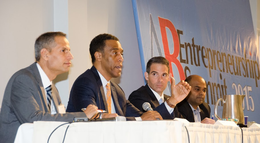 "Senior Director of Philanthropy & Development at American India Foundation Venky Raghavendra (left), Rey Ramsey (second left), Managing Partner at Fourth Sector Capital and Senior Advisor at Opterna International, The Benval Group Chief Investment Officer Rodney Lake and TechFetch.com Founder and CEO Praba Murugaiah (right) during the panel ""Accessing capital: seed, venture, federal and city funding"" at the American Bazaar Entrepreneurship Summit in Washington, DC, on April 25, 2015."