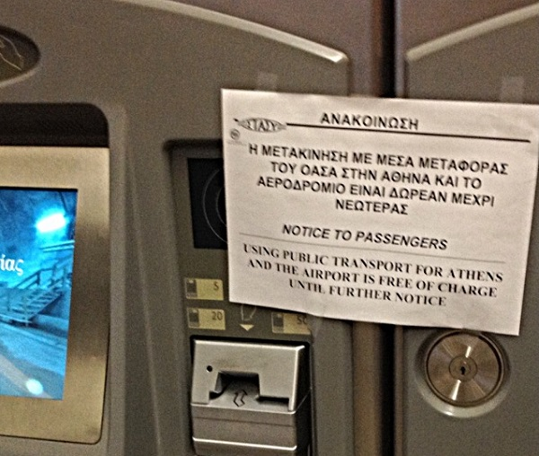 "Sign at a metro station: ""Using public transport for Athens is free of charge until further notice."""