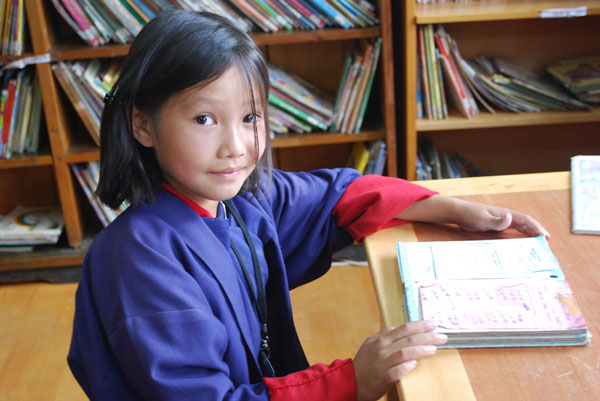 Bhutan-girl-in-READ-Library-credit-READ-Global