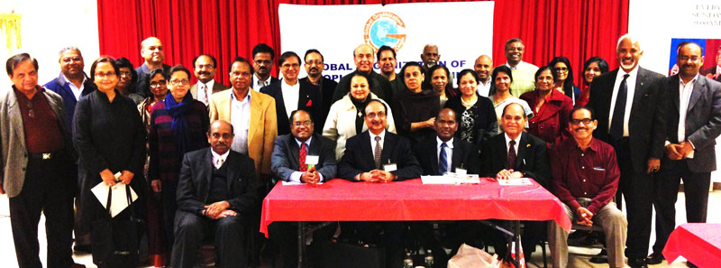 Speakers, organizers and some participants at the recently held community meeting on NRI Property Issues in India. Seated in front row from L. to R.: Kerala Center President Thambi Thalappillil, GOPIO Founder President Dr. Thomas Abraham, GOPIO-New York President and panelist Anand Ahuja, Panelist Pambayan Meyyan, GOPIO-New York Founder President Lal Motwani and Kerala Center Executive Director E.M. Stephen