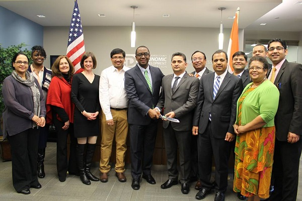 PG County Economic Development Corporation President and CEO James Coleman (sixth from left) and Allied Deccan Director G. Raj Pant (seventh from left) at the ribbon-cutting ceremony on November 17, 2015.