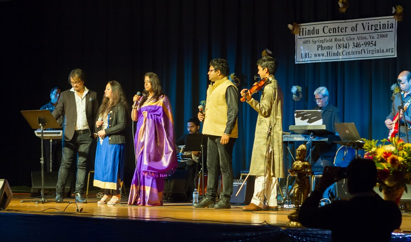 Kavita Krishnamurthy (center) performing in Richmond on March 20, 2016. Her son Ambi Subramaniam is on violin on the right.