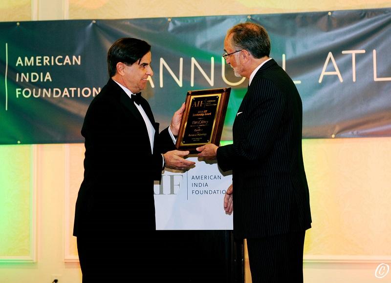 Eduardo Martinez, CEO of UPS Foundation, receiving AIF honor from Ambassador Charles Shapiro on behalf of David Abney at the AIF gala on April 2, 2016. Photo credit: ByteGraph