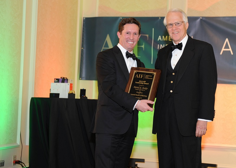 Xylem Inc. CEO Patrick Decker (left) after receiving the award from Phil Bolton, President of Global Atlanta, at the AIF gala on April 2, 2016. Photo credit: ByteGraph