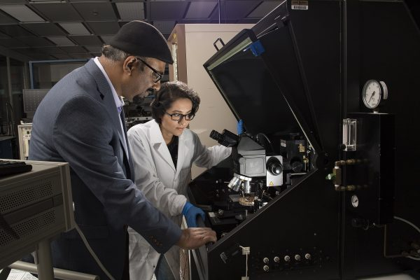 Purdue University researchers Aida Ebrahimi, a doctoral student, and Muhammad Ashraful Alam, the Jai N. Gupta Professor of Electrical and Computer Engineering, are working to develop a new type of electronic sensor to detect and classify bacteria for medical diagnostics and food safety. (Purdue University photo by John Underwood)