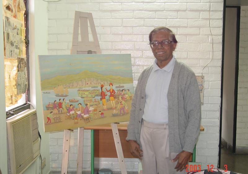 Cartoonist Samuel with his watercolors at his studio. New Delhi. 2003.