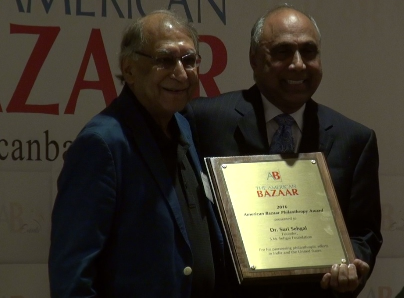 Dr. Suri Sehgal receiving the American Bazaar Philanthropy Award from Frank Islam in Washington, DC, on October 1, 2016.