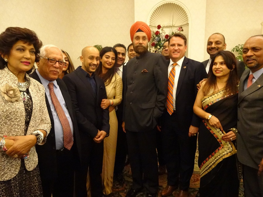 Ambassador Sarna pose for a photo with members of the Indian American community in Fairfax, VA, on Sunday. Photo by Geeta Goindi