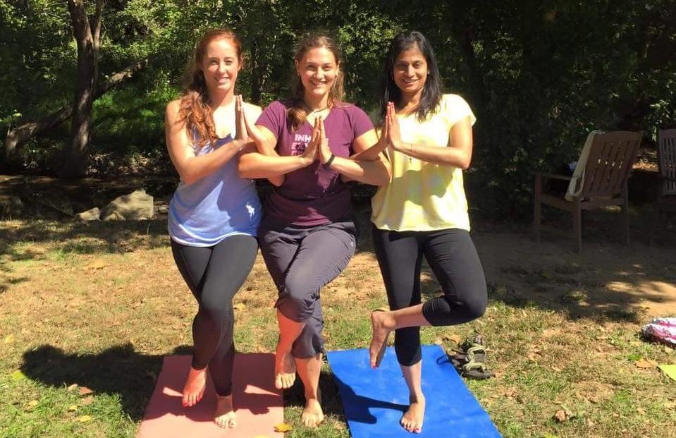 Three members of the Washington-area fitness group Beautiful Brown Bodies strike a yoga pose.