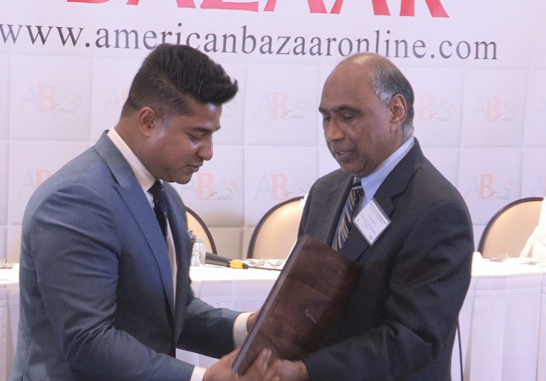 Ajay Raju receiving the American Bazaar Philanthropy Award