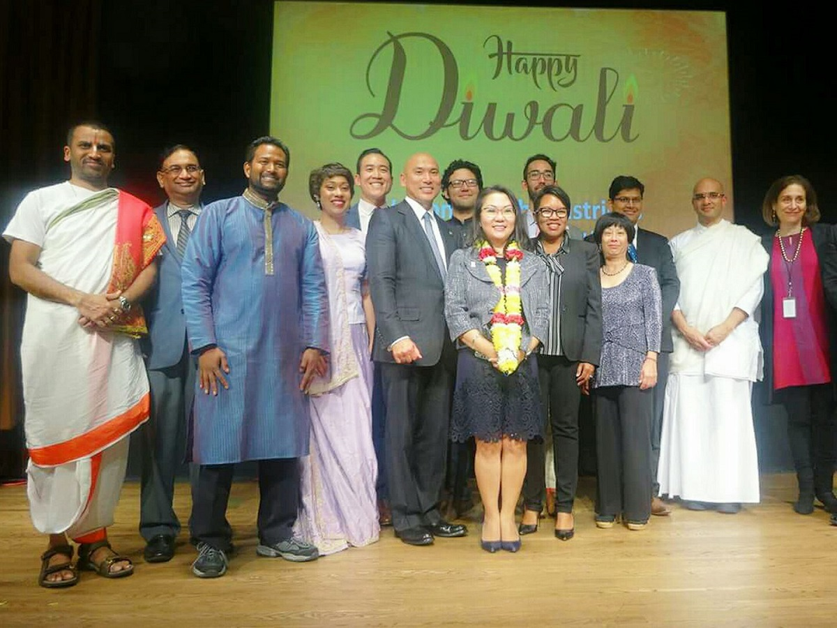 At a Diwali celebration hosted by DC Mayor's Office of Asian and Pacific Islander Affairs (MOAPIA), held at the Smithsonian's Freer Gallery of Art, are seen: Deputy Mayor for Health and Human Services Hyesook Chung (center); Pandit Venkatacharyulu of Sri Siva Vishnu Temple (left); Atul Rawat, general manager of SSVT (second from left); emcee Sonya Gavankar (fourth from left); David Do, executive director of MOAPIA (fifth from left); Charon Hines, director of the Mayor's Office of Community Affairs (fifth from right); Brahmachari Vrajvihari Sharan, director of Hindu Life at Georgetown University (second from right); Debra Diamond, curator at the Freer-Sackler galleries (right); and DC AAPI commissioners