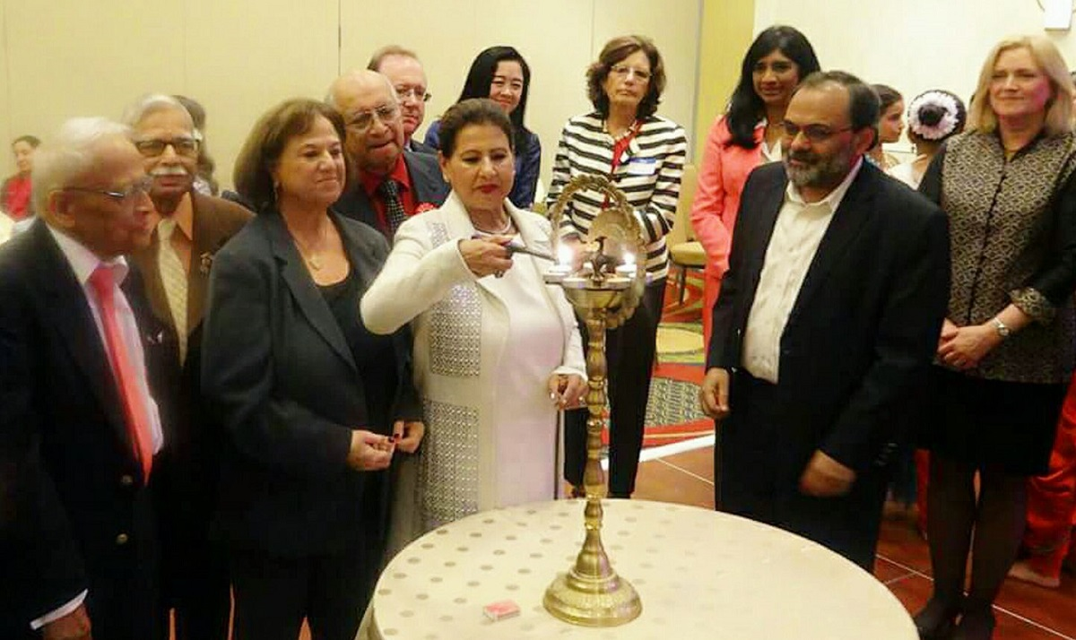 Amdex Corporation President and CEO Devinder Kaur Singh lighting the lamp at the 2017 NFIA Empowering Women and Girls Conference held at the Marriott hotel in Tysons Corner, Virginia.