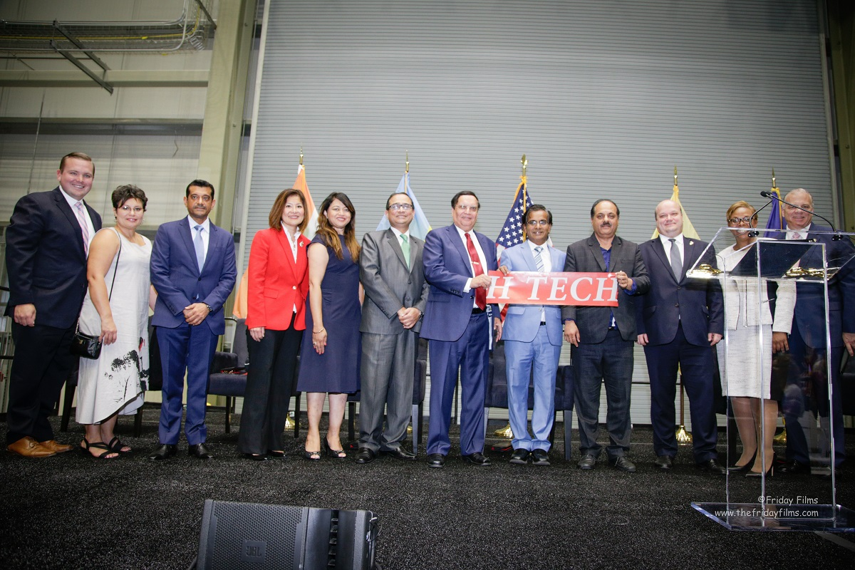 Dr. Kris Singh (seventh from left) and Dr. Sanjay Gupta (fifth from right) at the ribber-cutting ceremony of Holtec International's new Singh Nuclear Technology Campus in Camden, NJ, on September 15, 2017.