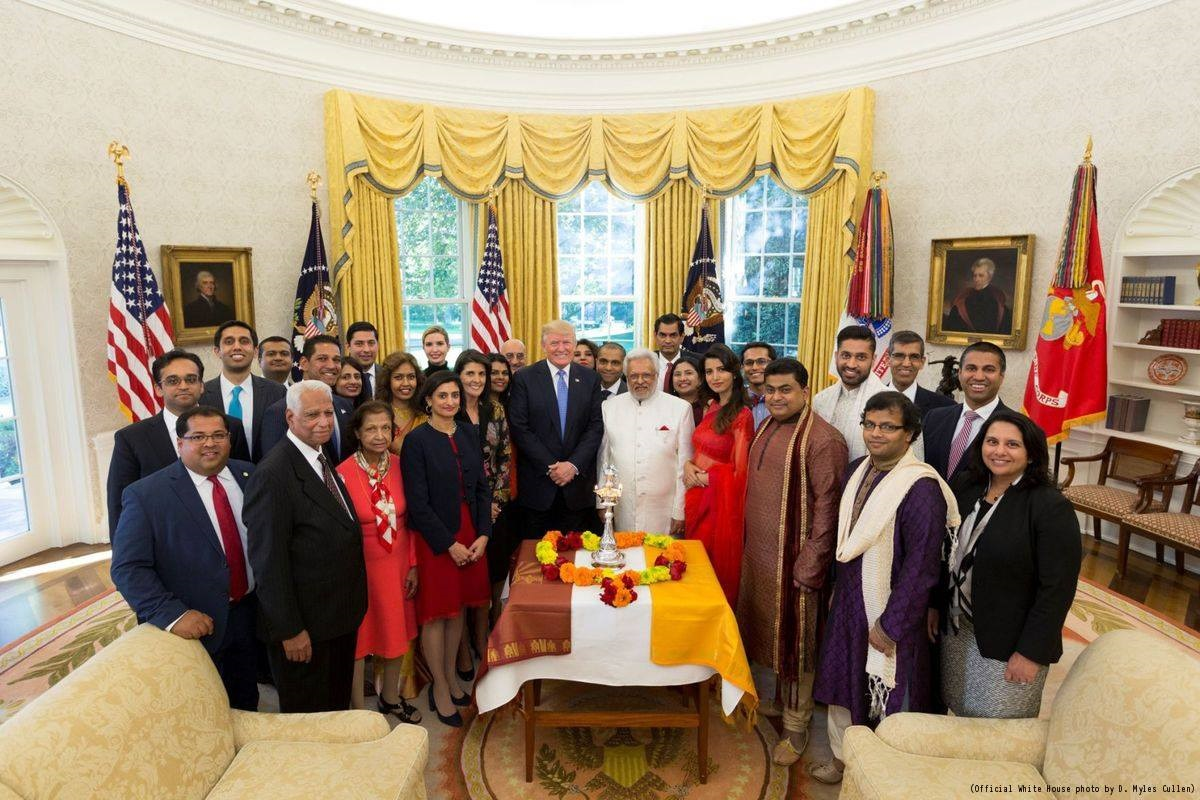 President Donald J. Trump poses in a group photo with US United Nations Ambassador Nikki Haley (left), following a Diwali ceremonial lighting of the Diya in the Oval Office at the White House, Tuesday, October 17, 2017, in Washington, DC.