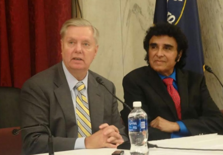 Senator Lindsey Graham (Republican-South Carolina) addresses the 20th Annual Legislative Conference organized by the Indian American Friendship Council (IAFC) on Capitol Hill. Seated at right is IAFC founder and chairman Dr. Krishna Reddy.