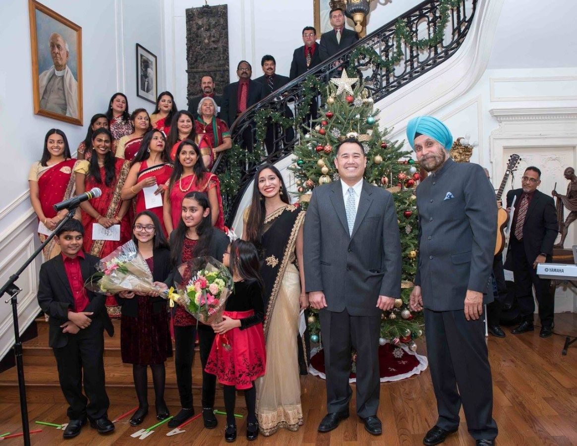 Indian Ambassador Navtej Sarna (front right) and US Under Secretary of Transportation for Policy Derek Kan (second from right) with singers of the Indian American Catholic Association Choir Ministry at the 2017 Christmas celebration held at the Embassy of India in Washington.