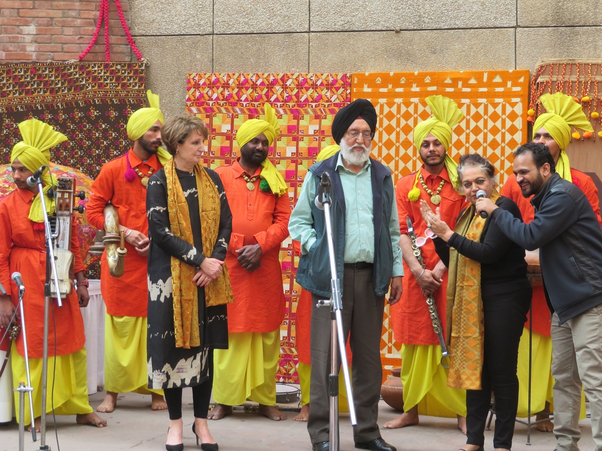 At the fifth annual Mela Phulkari are seen in the front from left to right: MaryKay Carlson, Deputy Chief of Mission at the American Embassy in Delhi; former Union Minister M.S. Gill; art historian Dr. Alka Pande; and RJ Jassi of Chandigarh. Looking on are the Sardars of Sangrur, exceedingly talented musicians highlighting the folk instruments of Punjab