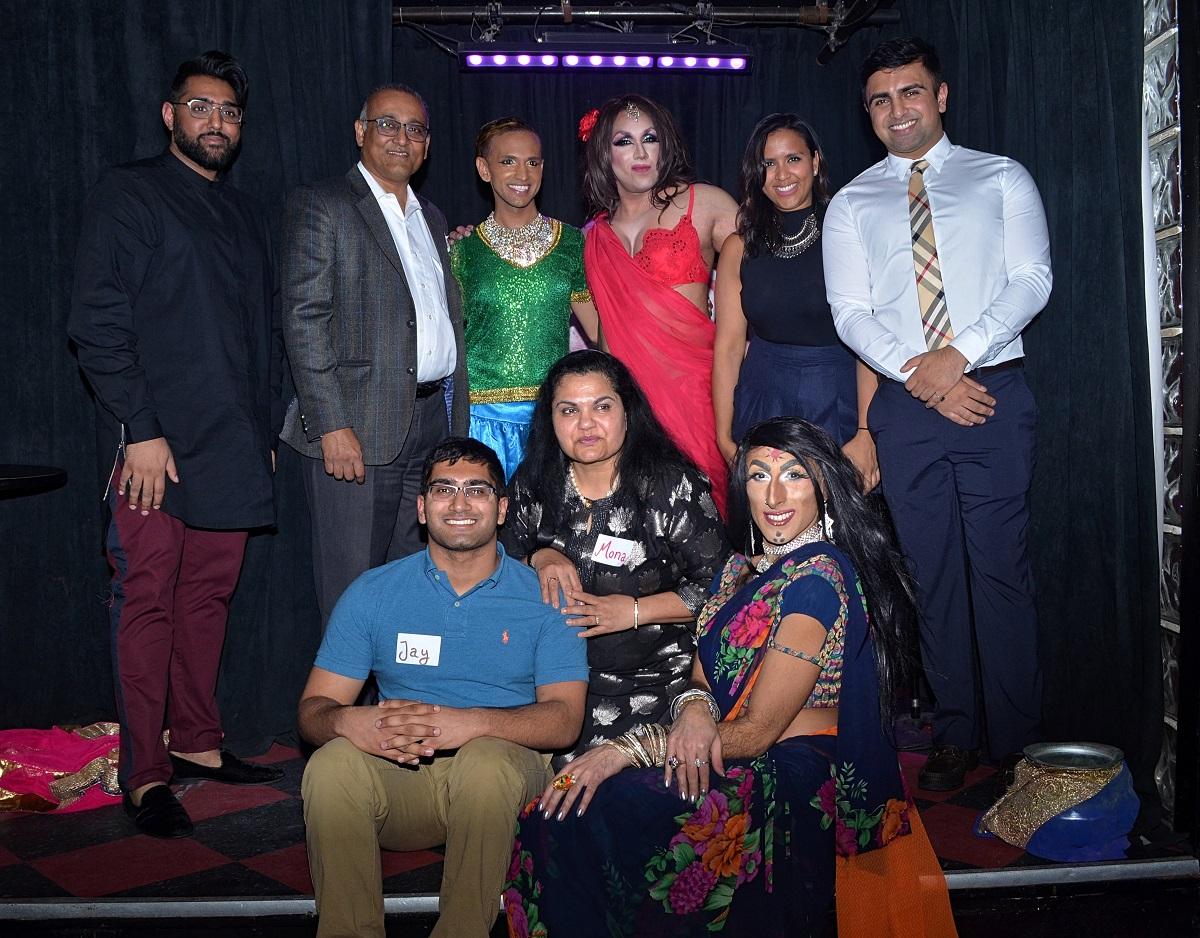 From left to right, standing: Rohan Sheth, Prashant (Paul) Patel, International Dancer Zaman, Hariqbal Basi, Roshani Patel, and Joshua Patel. Sitting: Jaykishan Patel, Mona Patel, Lal Batti