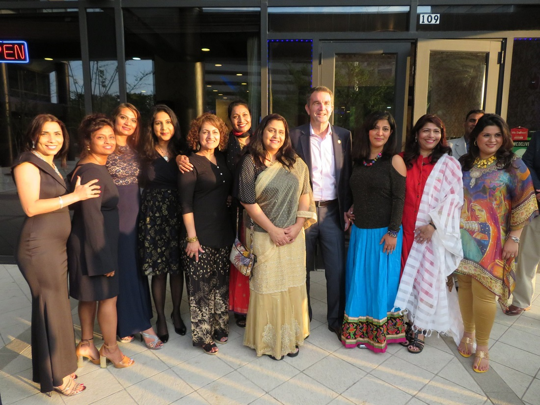 Virginia Governor Ralph Northam is flanked by Indian American female activists at an event celebrating Asian American and Pacific Islander Heritage Month, held in Tysons Corner on May 20, 2018 .