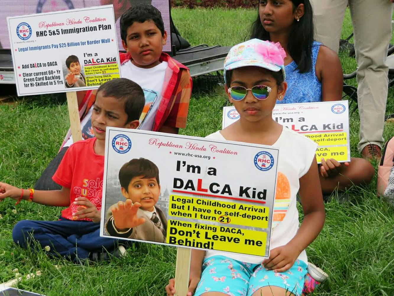 An Indian DALCA kid holds a sign at an immigration rally on Capitol Hill asking US lawmakers to include protections for legal Dreamers in any immigration reform legislation