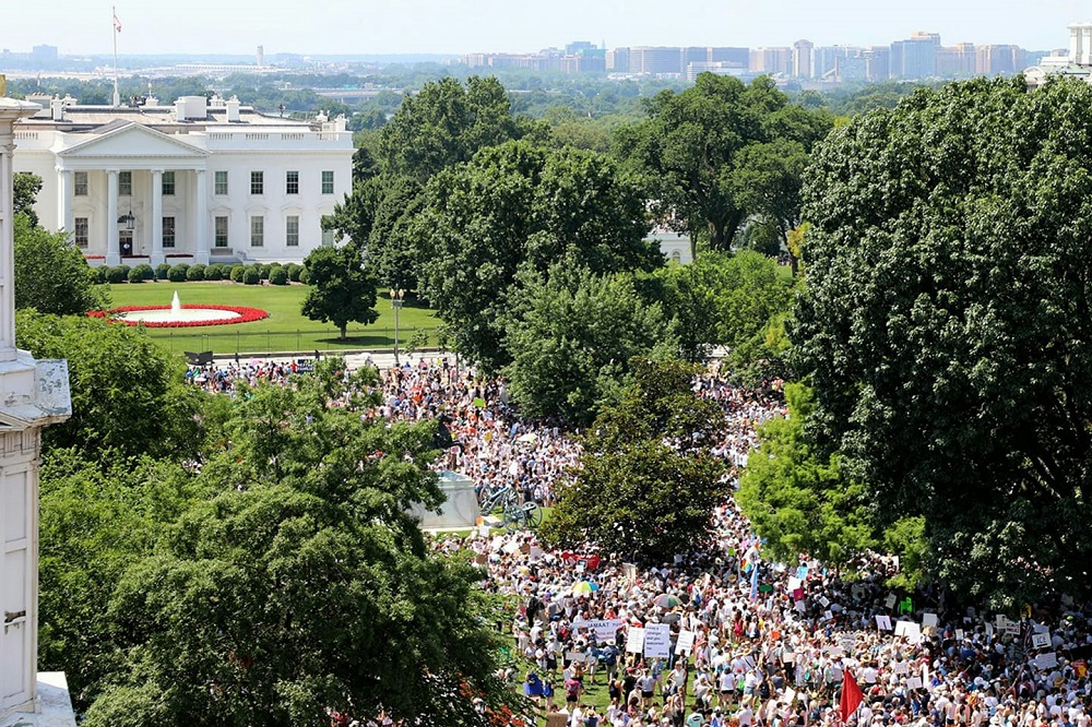 Crowds pack Lafayette Park, across from the White House, for the Families Belong Together rally, one of over 600 held across the country to protest President Trump's immigration policies.