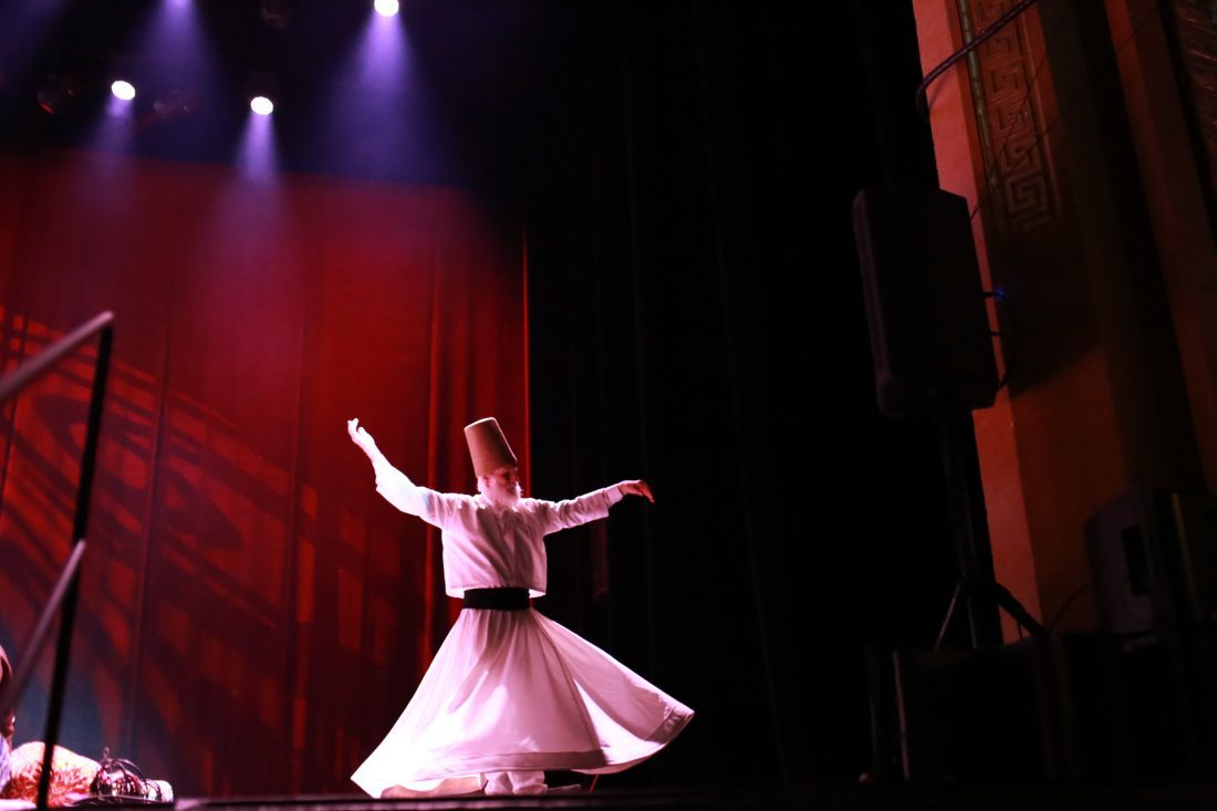 A whirling dervish performing at Warner Theater in Washington, DC