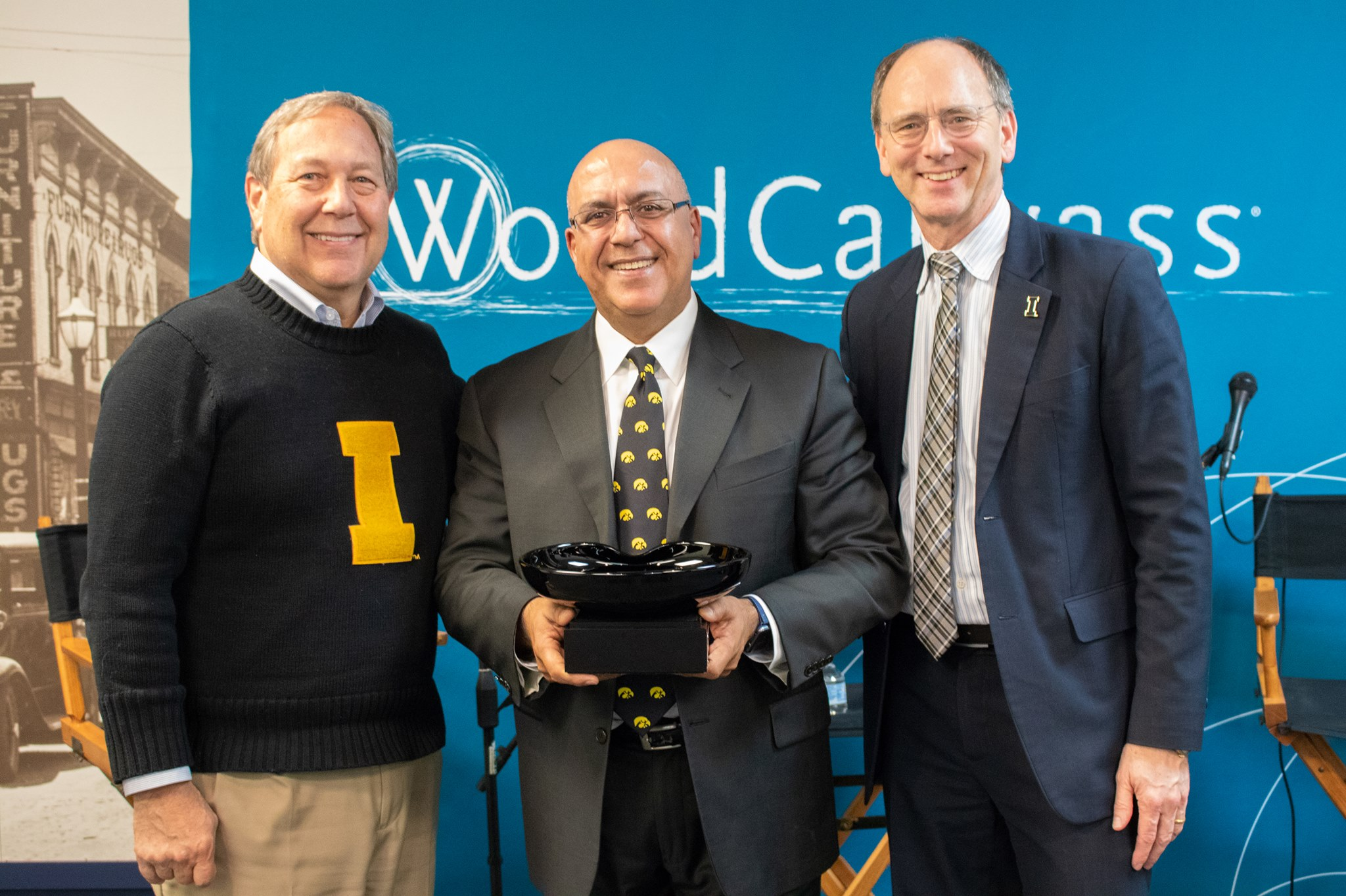 Sehgal Foundation's Rajat Jay Sehgal (center) with the University of Iowa's International Impact Award. Also seen are university President Bruce Harreld (left) and Downing A. Thomas, associate provost and dean of International Programs at the university.