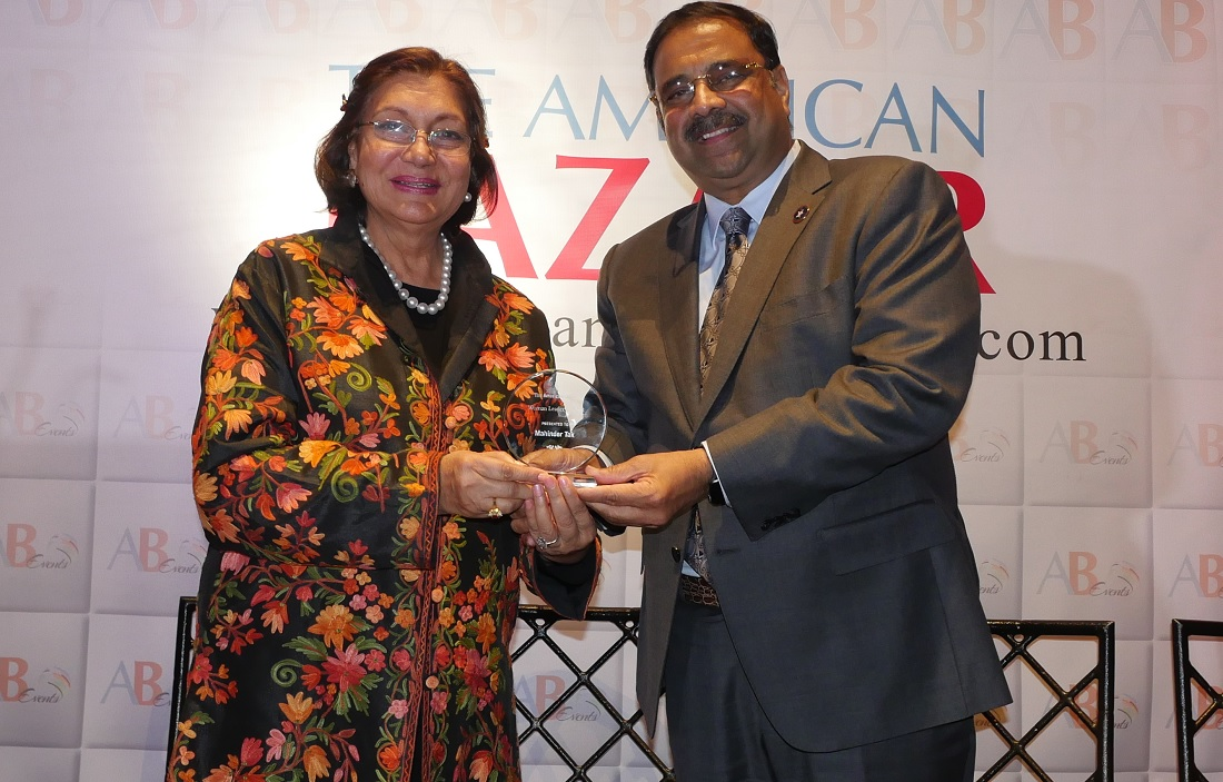 Indian American fundraiser and art collector Mahinder Tak receiving the American Bazaar Women Leader of the Year award from prominent Indian American entrepreneur Danny Gaekwad in Bethesda, MD, on November 16, 2018.