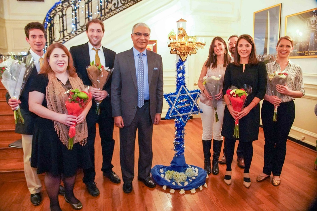 Deputy Chief of Mission Santosh Jha (fourth from left) with members of a Jewish young professionals group who rendered Hanukkah songs at the 16th annual celebration held at the Indian Chancery in Washington, DC. Photo credit: Embassy of India, Washington