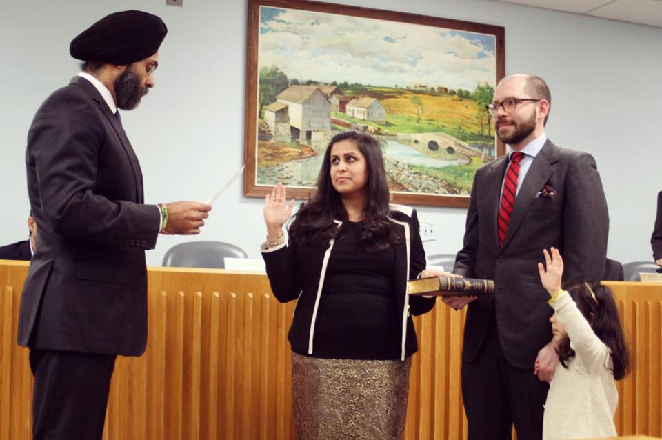 Sadaf Jaffer (center) is being sworn in as Mayor of Montgomery Township by New Jersey Attorney General Gurbir Grewal