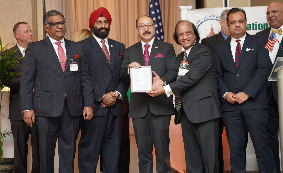 Indian Ambassador to the United States Harsh Vardhan Shringla receiving a welcome citation from NCAIA Chairman Dr. Suresh Gupta.
