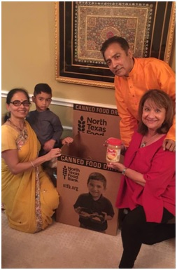 Anna and Raj Asava, co-founders and co-chairs of the North Texas Food Bank's Indian American Council, with their grandson and Colleen Brinkman, getting ready for a food drive.