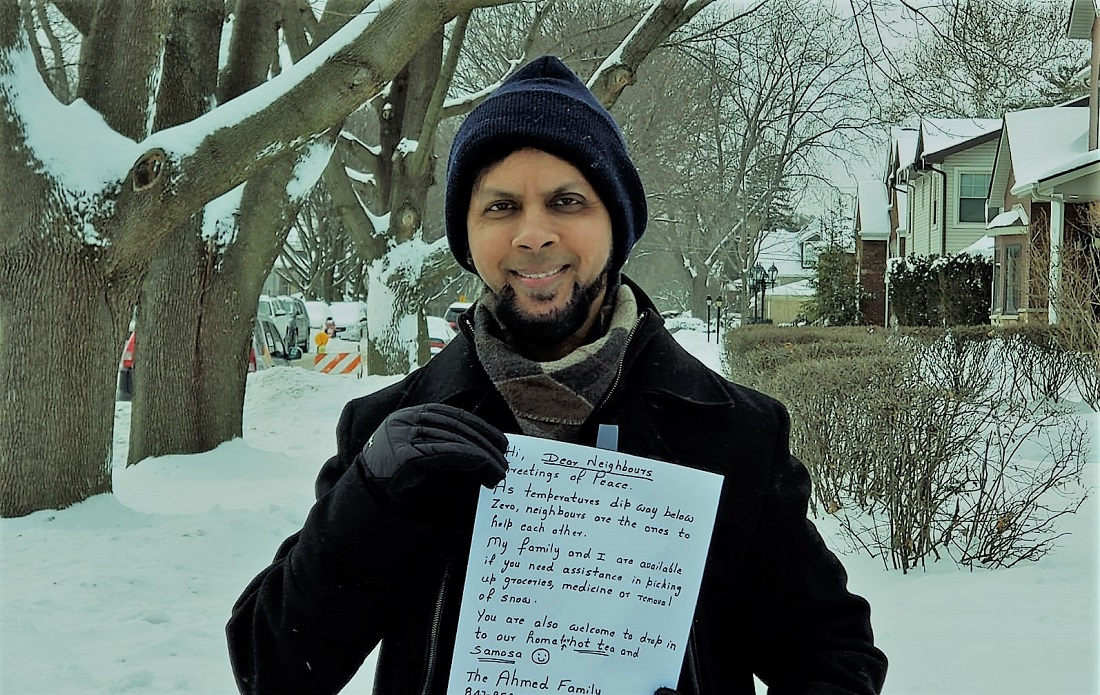 Sabeel Ahmed with the letter offering help to neighbors during Polar Vortex.