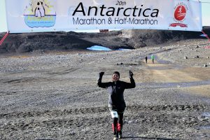 Rupal crossing the finish line in Antarctica