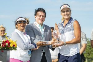 Dr. Kiran Patel presenting the ShopRite LPGA Classic trophy to Lexi Thompson on June 9, 2019.