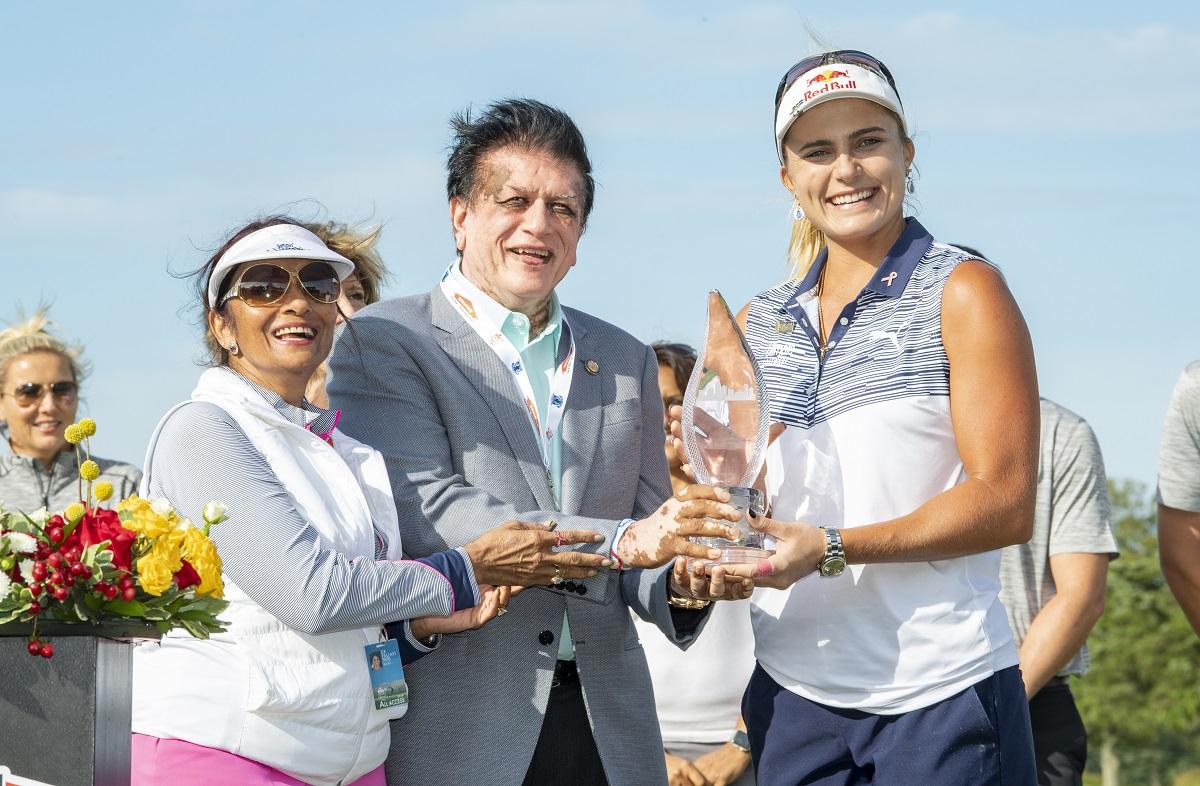 Dr. Kiran Patel presenting the ShopRite LPGA Classic trophy to Lexi Thompson on June 9, 2019.