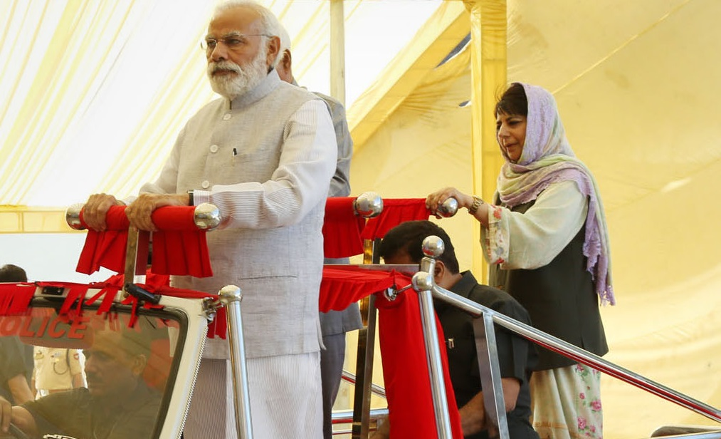 Prime Minister Narendra Modi while visiting Jammu and Kashmir in April 2017. Also seen is the-then Chief Minister Mehbooba Mufti. Last week, Modi's government revoked special privileges enjoyed by Jammu and Kashmir. Photo credit: PIB