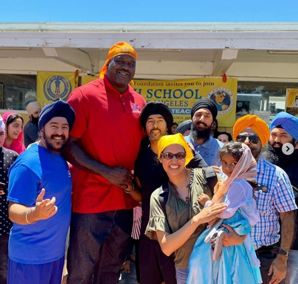 Shaq posing for a photo with devotees at the Khalsa Care Foundation in Pacoima, California.