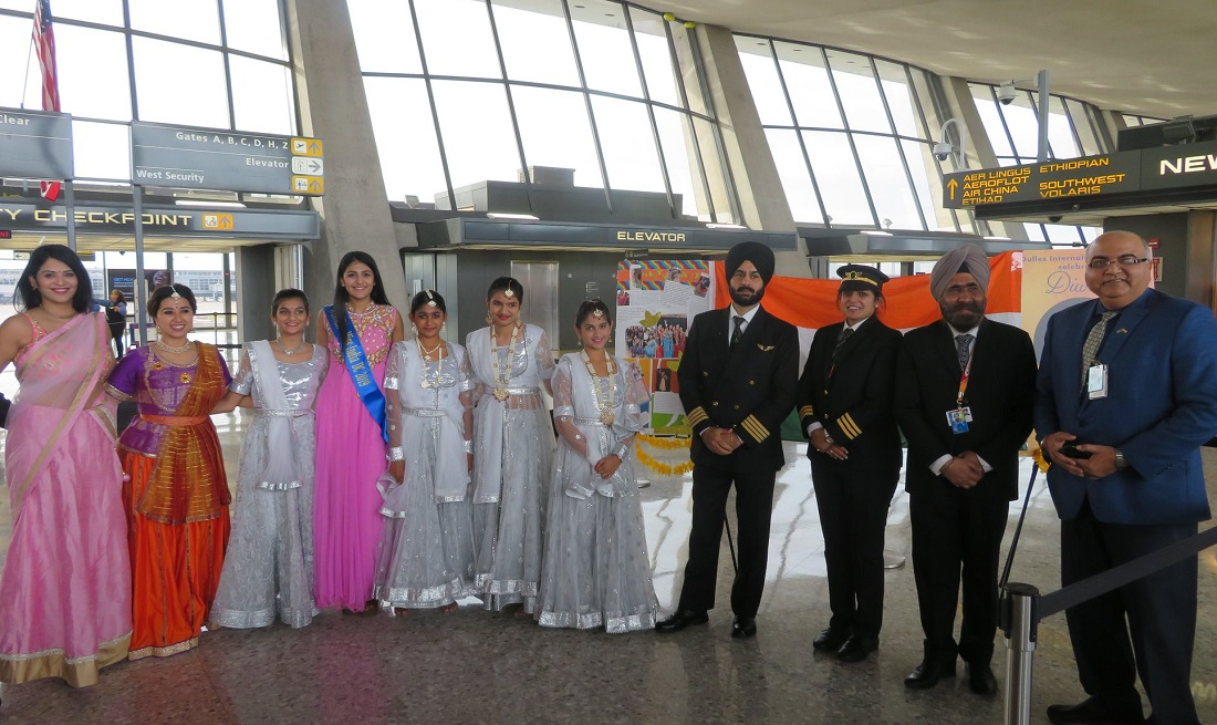 For the first time, Diwali was celebrated at the Washington Dulles International Airport. Seen from left to right are: Shweta Misra, founder and director of Nrityaki Dance Academy, with her students; Air India flight crew; and personnel of the Metropolitan Washington Airports Authority.