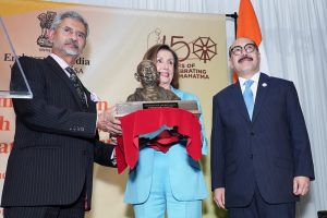 House Speaker Nancy Pelosi receiving a bust of Mahatma Gandhi from India's External Affairs Minister S. Jaishankar